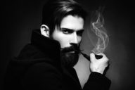 Black and white portrait of hipster man smoking